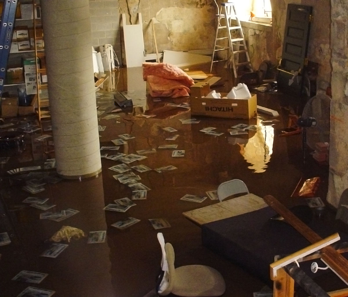 Flooded basement with articles and items strewn about